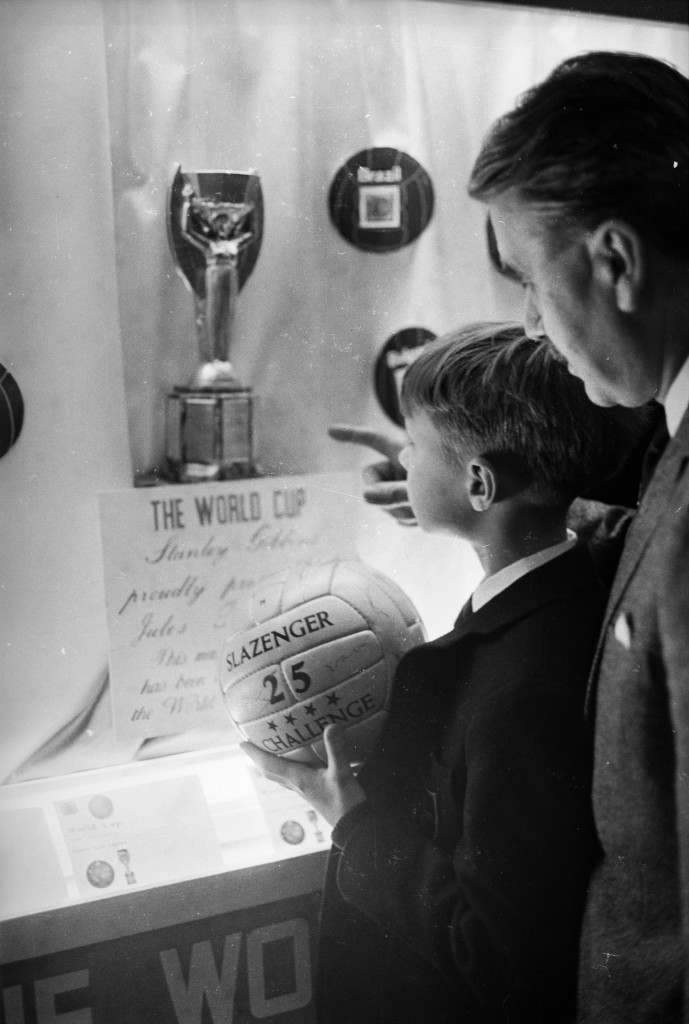 18th March 1966:  A young boy and a man looking at the Jules Rimet world cup trophy during a British stamp exhibition.  (Photo by M. McKeown/Express/Getty Images)