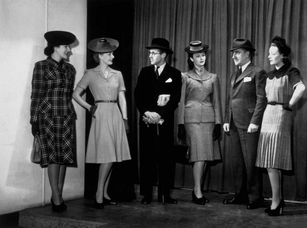 circa 1942:  Models at Bush House, London, displaying clothes made from government utility materials, at the first mixed mannequin show ever held.  (Photo by Keystone/Getty Images)