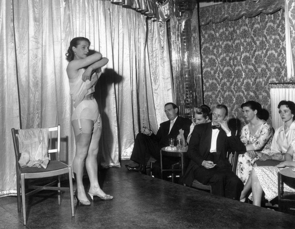 sex, stripping, London, Raymond REvue, Soho, An amateur stripper performing at the Raymond Revuebar in London. Audience members may enter the striptease contest and the winners are awarded