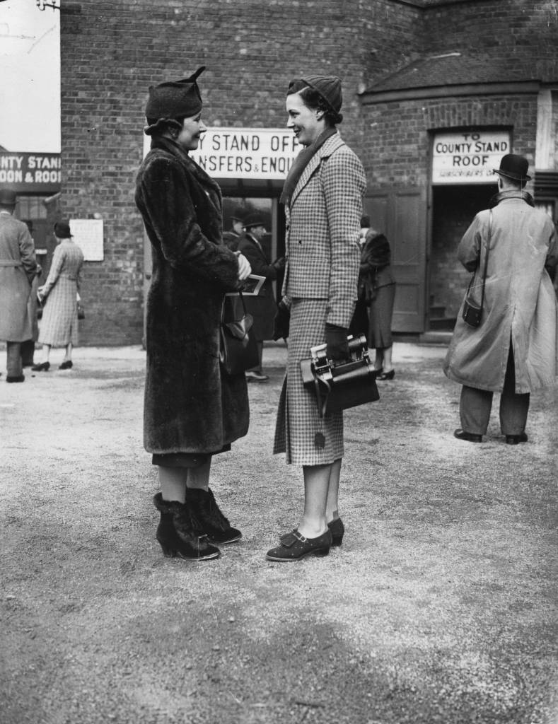 19th March 1937:  Two women in the paddock at Aintree racecourse, Liverpool.  (Photo by E. Dean/Topical Press Agency/Getty Images)