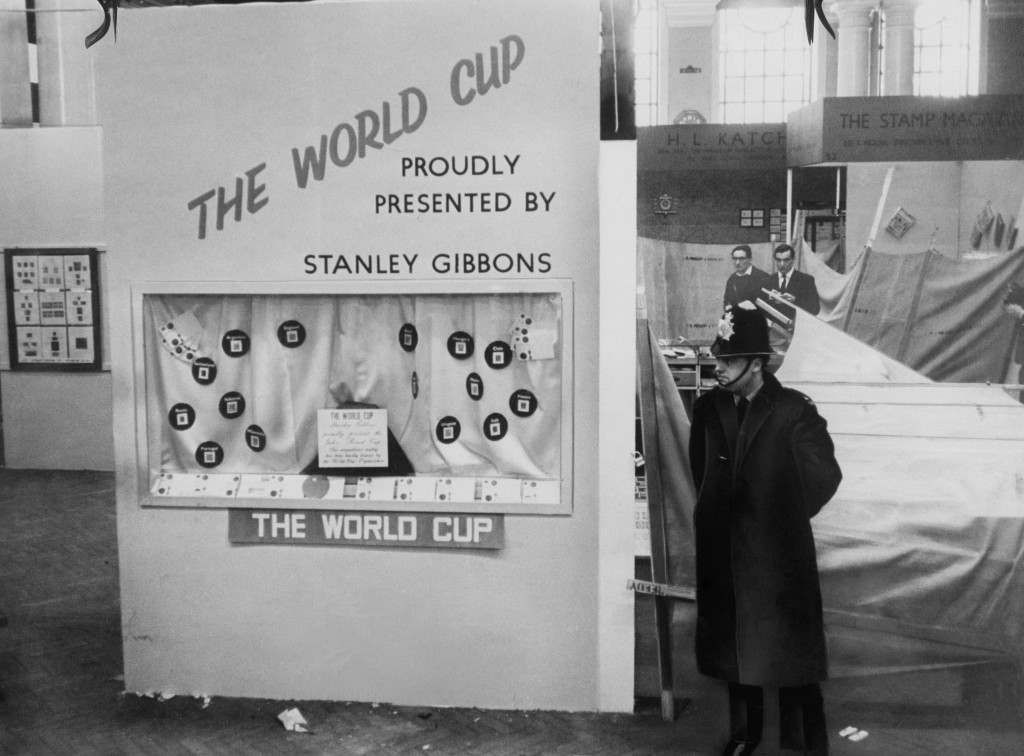A policeman stands guard in Central Hall Westminster, next to the stand at the National Stamp Exhibition where the Jules Rimet trophy was housed before it was stolen, 21st March 1966. The World Cup competition is to be held in England later in the year. (Photo by Keystone/Hulton Archive/Getty Images)