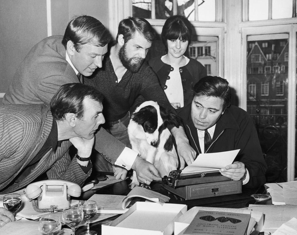 Pickles, the dog who found the stolen World Cup trophy, is offered a part in the comedy film 'The Spy with a Cold Nose', 29th March 1966. With him are (left to right) actor Eric Sykes (1923 - 2012), Pickles' owner David Corbett, screenwriter Ray Galton, Pickles' owner Jean Corbett and screenwriter Alan Simpson.  (Photo by Central Press/Hulton Archive/Getty Images)