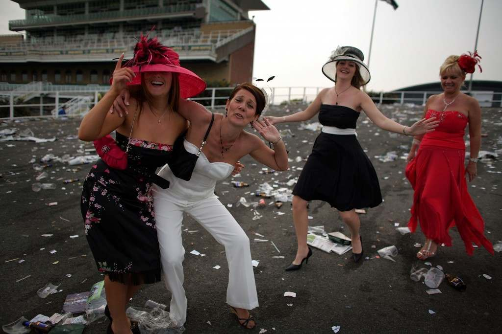 LIVERPOOL, UNITED KINGDOM - APRIL 13:  Ladies make their way home at the end of Ladies Day on the second day of the Grand National meeting at Aintree Racecourse on 13 April 2007, Liverpool, England. Friday is traditionally Ladies day at the three-daymeeting of the world famous Grand National which takes place on saturday over a course of four miles and four furlongs  (Photo by Christopher Furlong/Getty Images)