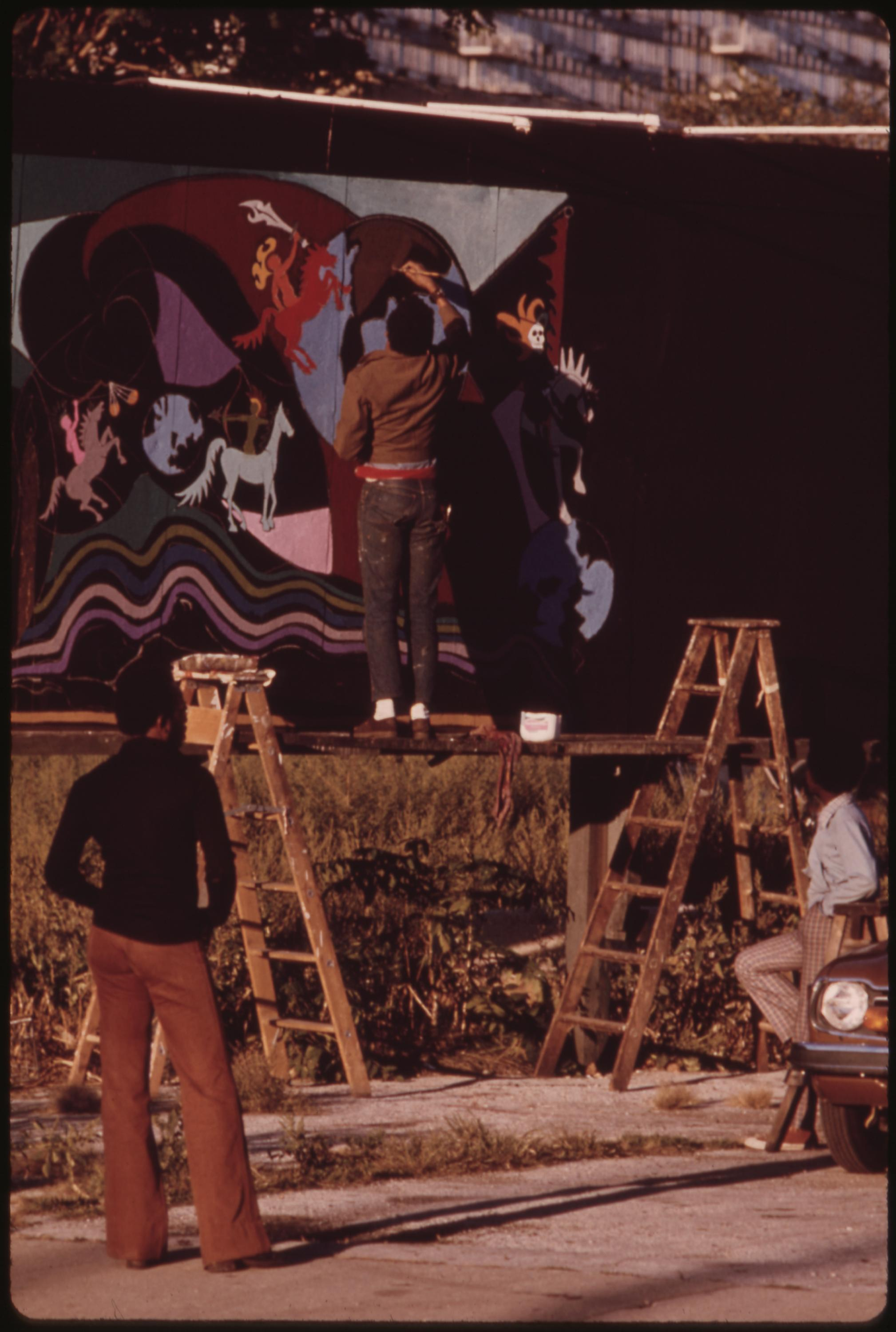 Artist Ron Blackburn Painting An Outdoor Wall Mural At The Corner Of 33rd And Giles Street In Chicago, 06:1973