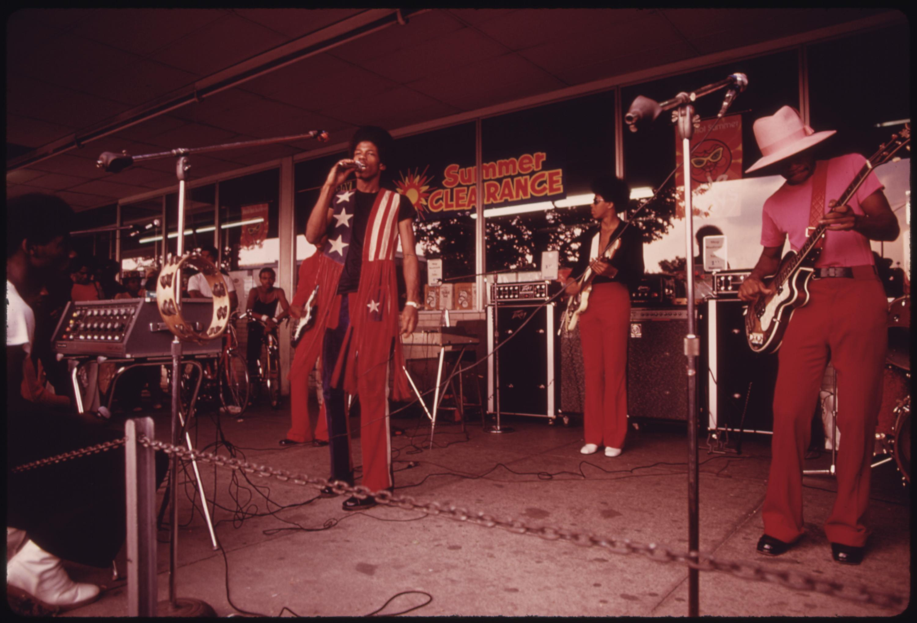 Band Performs At The Lake Meadows Shopping Center In Chicago, 08:1973 John H. White