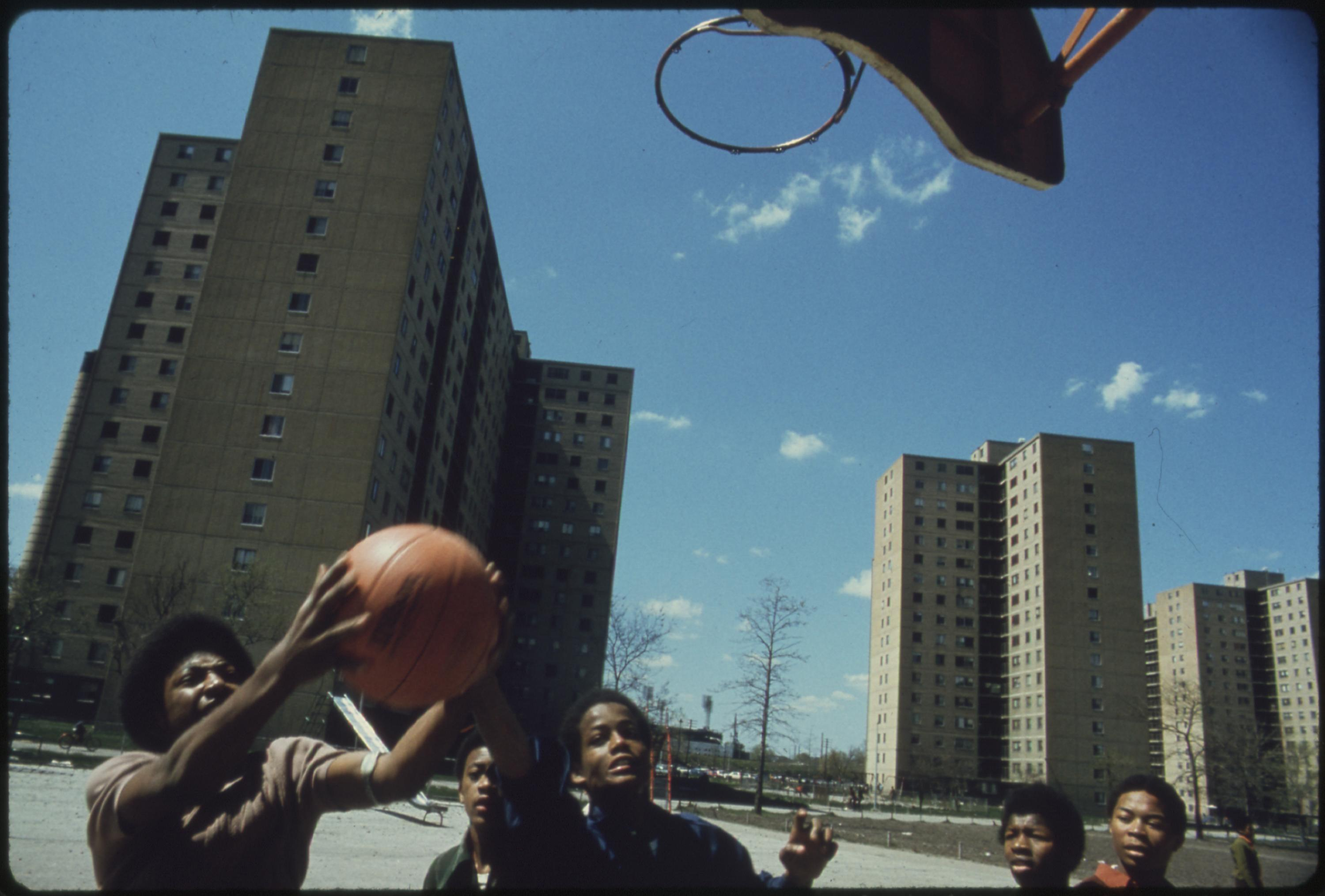 Black Youths Play Basketball At Stateway Gardens' Highrise Housing Project On Chicago's South Side, 05:1973