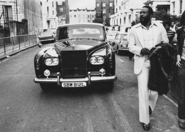 6th October 1976: American soul singer Marvin Gaye (1939 - 1984) walking ahead of his Rolls Royce in Notting Hill, London. (Photo by John Minihan/Evening Standard/Getty Images)