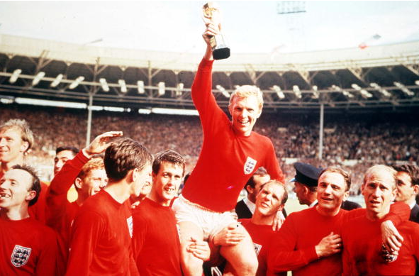 World Cup Final, 1966, Wembley, England, 30th July, 1966 England 4 v West Germany 2, Englands captain Bobby Moore holds aloft the Jules Rimet World Cup trophy as he sits on the shoulders of his teammates after the match