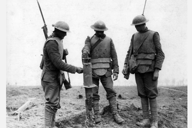 Caption:A British field party of the Irish Guard at the Battle of Pilckem Ridge, wearing breastplate armour for protection against stray bullets