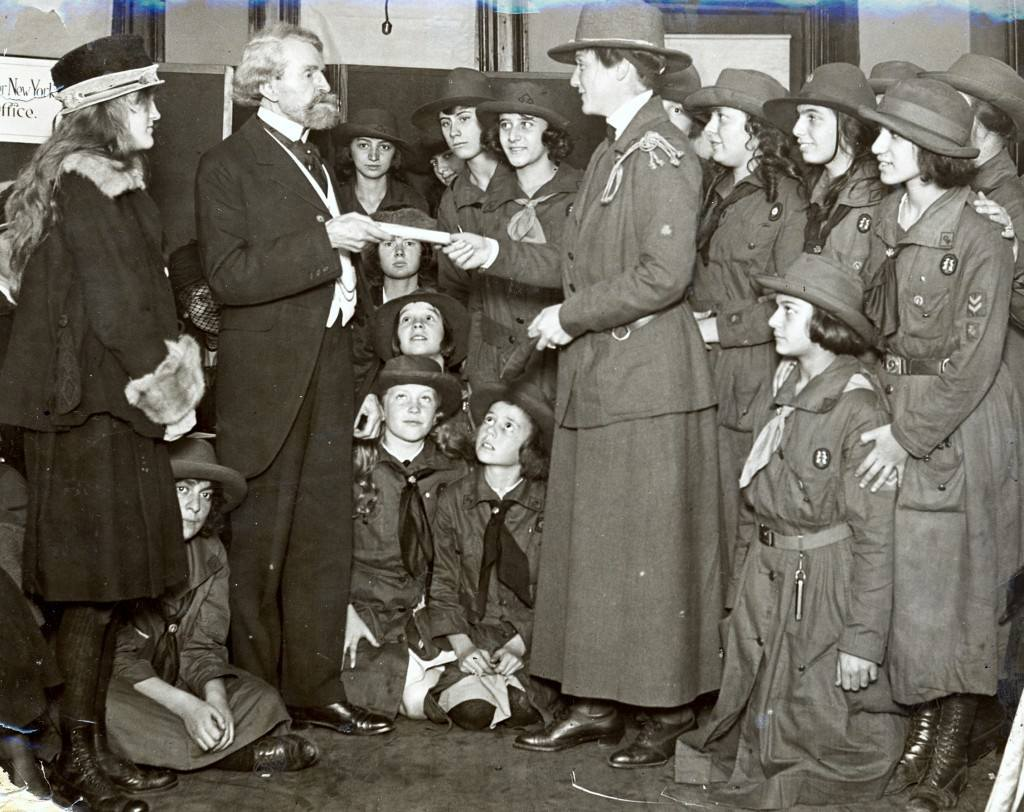 After the death of 16-year-old daughter Andrée Clark from meningitis in 1919, W.A. Clark gives the deed to land for the first national girl scout camp, Camp Andrée Clark, in New York. Huguette Clark, 13, stands with her father.
