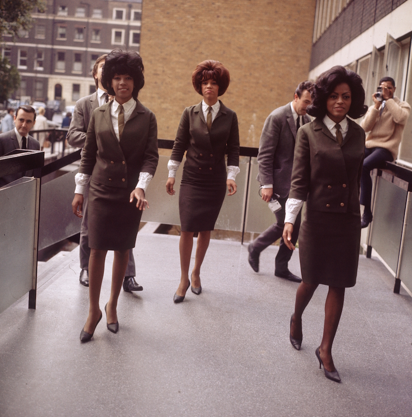 Wearing identical suits even though not performing, The Supremes, one of the most popular of American female vocal groups. (Photo by Hulton Archive/Getty Images)