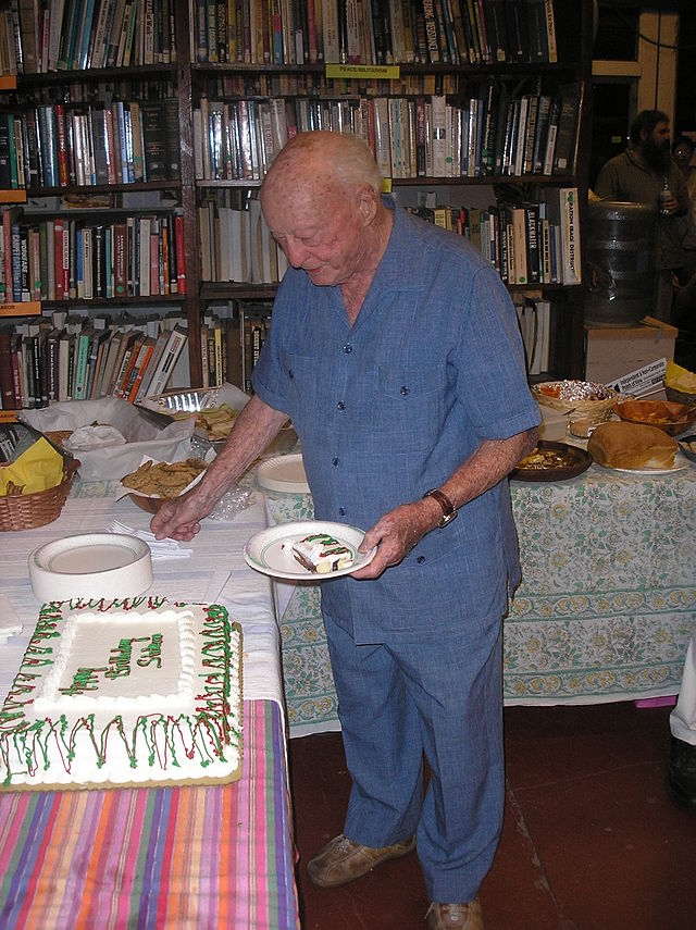 Stetson Kennedy cuts the cake for his 93rd birthday party (two days before the actual birthday) at the Civic media Center in Gainesville, Florida.