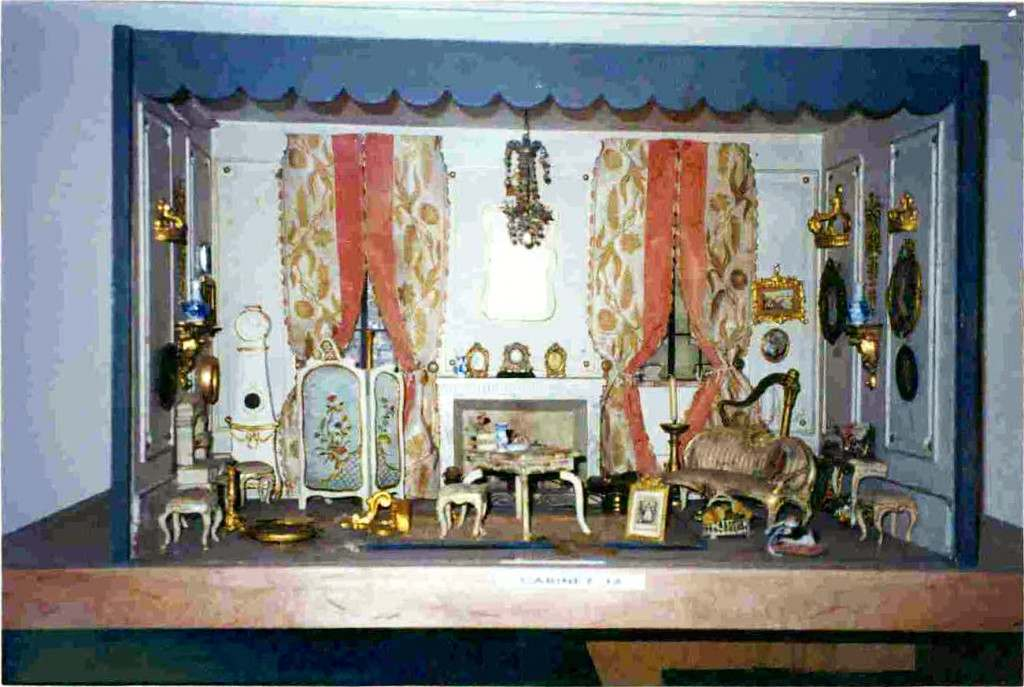 Dollhouse furniture and accessories, organized on shelves in Huguette Clark's Fifth Avenue apartments. Taken from snapshots among her personal papers.