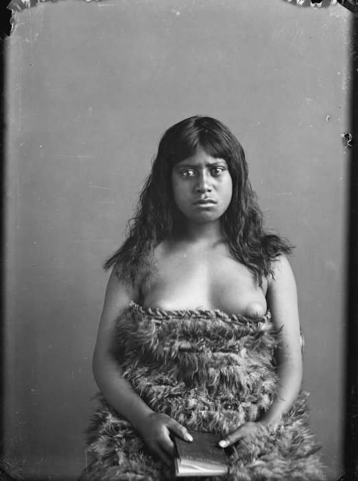 Carte de visite portrait of a Maori woman from the Hawkes Bay district, wearing a kahu huruhuru (feather cloak) beneath her breasts, taken between 1880 and 1890 by Samuel Carnell of Napier.