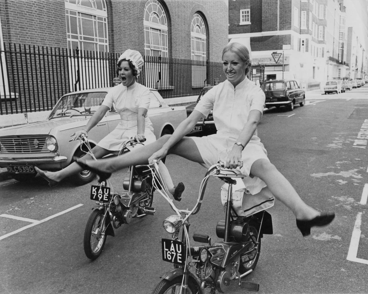 Models Glenda Warrington (left) and Caroline Whineray demonstrate the extra freedom and mobility afforded by the latest culotte dresses for nurses, 16th October 1967. The uniforms will be on show at the London Nursing Exhibition at Seymour Hall. October 16, 1967 (Photo by Keystone/Hulton Archive/Getty Images)