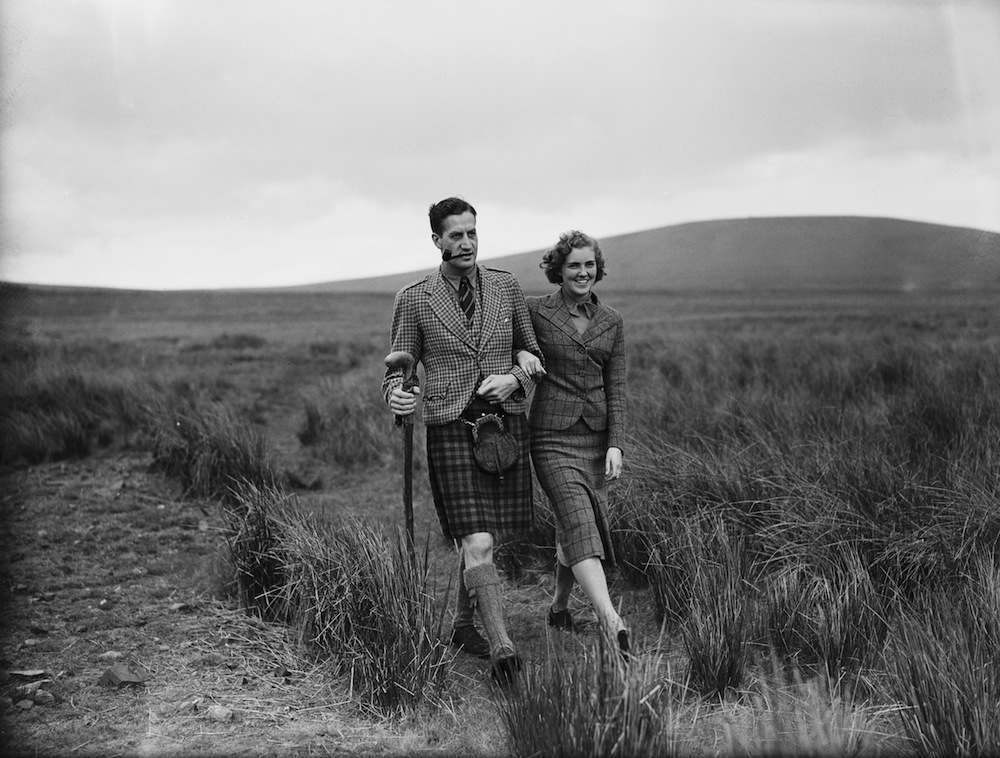 Ann Prunella Stack (1914 - 2010) out walking with her fiance, Lord David Douglas-Hamilton (1912 - 1944), son of the 13th Duke of Hamilton, near Dungavel Lodge, his home in Lanarkshire, Scotland, 2nd June 1938. Stack is leader of the Women's League of Health and Beauty, and member of the National Advisory Committee for Physical Fitness. (Photo by Fox Photos/Hulton Archive/Getty Images)