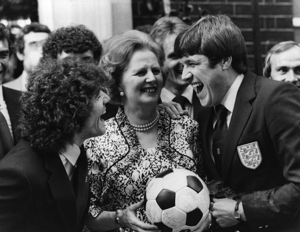 Emlyn Hughes and Kevin Keegan, members of the England Football Squad enjoying a joke with Mrs Margaret Thatcher outside No 10 Downing Street.  Original Publication: People Disc - HG0010   (Photo by David Levenson/Getty Images)
