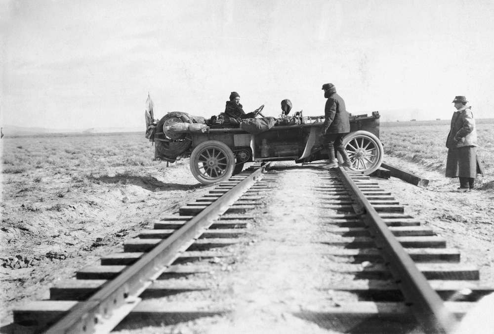American motorists in a Thomas Flyer have difficulty in crossing the Western Pacific Railway tracks 30 miles from Cobrey in Nevada, during the 169-day New York to Paris race.  Original