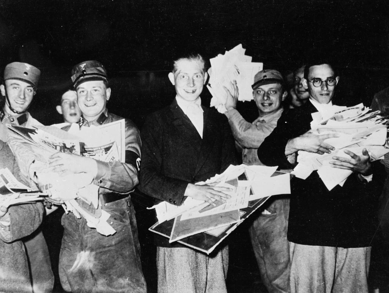 A group of Nazi troops and students gather seized papers and books to burn, in the Opernplatz, Berlin.   (Photo by Keystone/Getty Images)