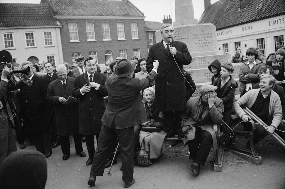 17th March 1966: Mr A. Duffy heckles a speech by British politician and Deputy Leader of the Labour Party George Brown (1914 - 1985) during the general election campaign. Mr Brown is speaking in front of the war memorial in Market Square, Fakenham, Norfolk. (Photo by McCabe/Express/Getty Images)