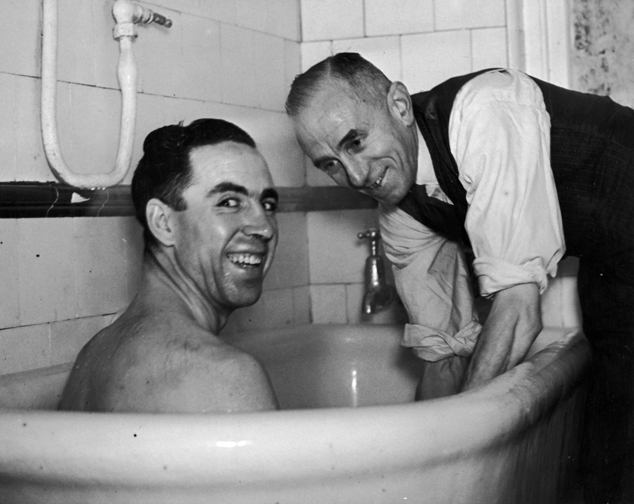8th January 1948:  West Ham wing half Norman Corbett having a knee massage from trainer Billy Moore. The West Ham team are visiting salt baths in Southend as preparation for their cup tie at Blackburn.  (Photo by George W. Hales/Fox Photos/Getty Images)