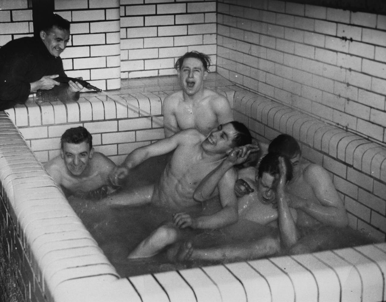 26th January 1937:  Five members of Sheffield United football club enjoy a bath after night training.  (Photo by Fox Photos/Getty Images)