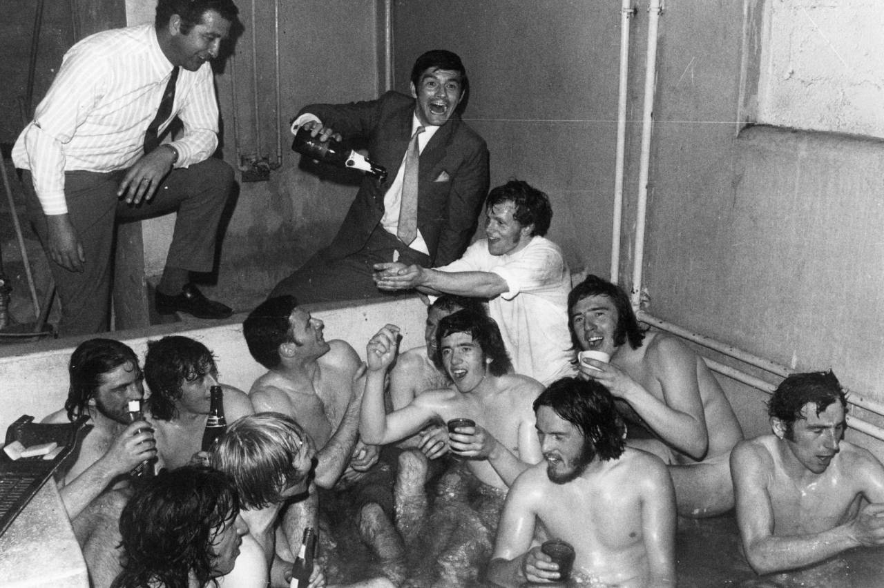 1965:  The Birmingham City team celebrate a win with champagne in the bath.  (Photo by Evening Standard/Getty Images)