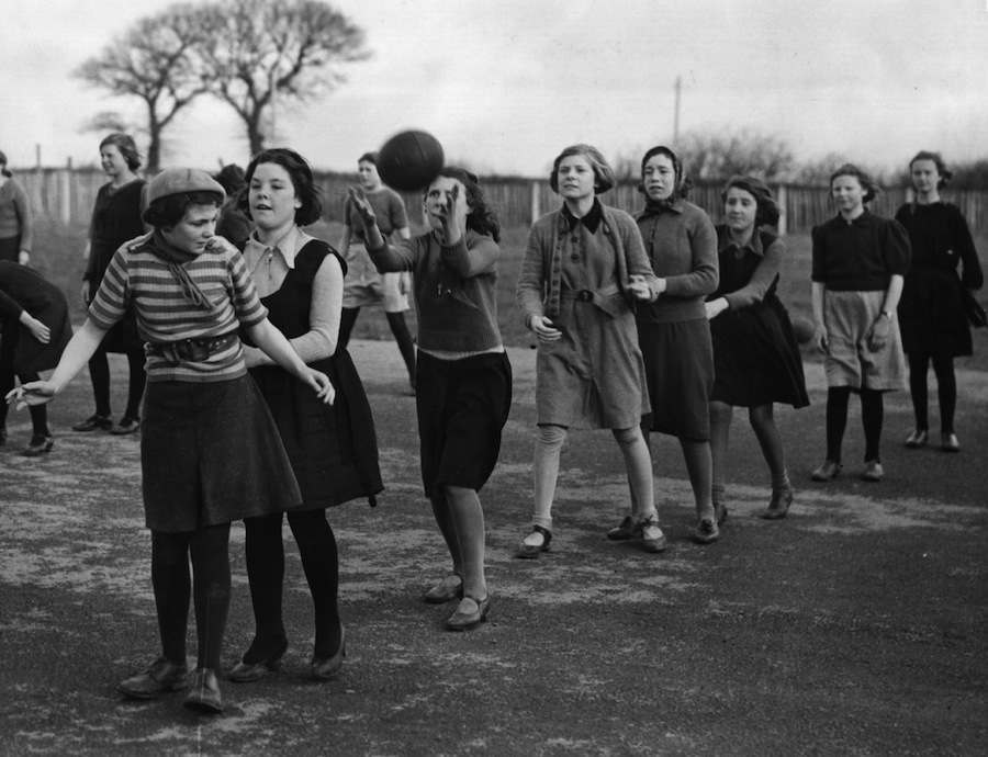 February 1939: Girls at games at Rhoose School Camp in the Vale of Glamorgan, which is run by the National Council of Social Service. The camp accommodates more than 300 children, has its own sick bay, kitchens and concert hall; it is regarded as the kind of camp the government may build for evacuation. (Photo by Fox Photos/Getty Images)