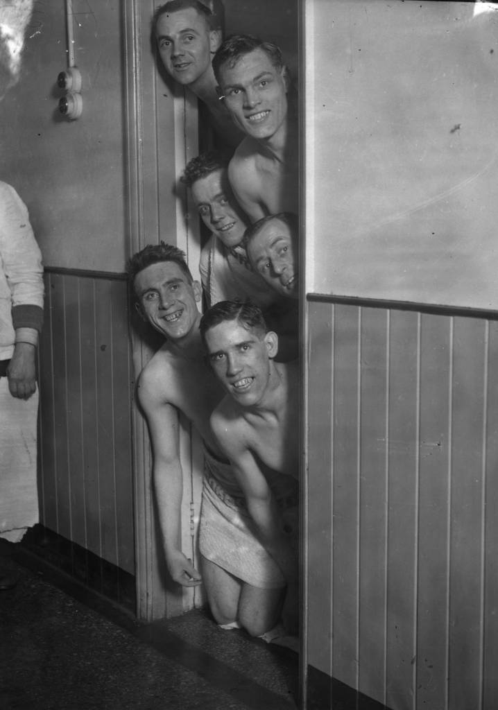 22nd January 1930:  Some of the Fulham Football Club team enjoy brine baths at Southend before their FA Cup tie with Nottingham Forest on Saturday. From top to bottom are : Craig, Gibbon, Haley, Rosier, Henderson, and Allen.  (Photo by J. A. Hampton/Topical Press Agency/Getty Images)