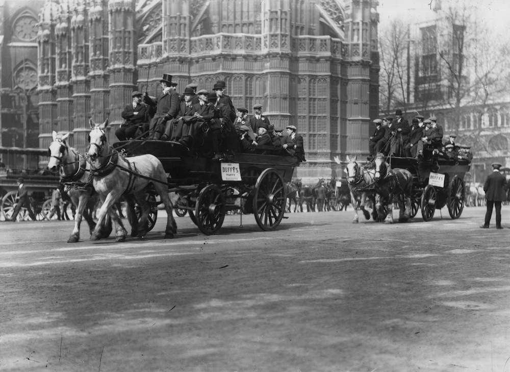 20th April 1912:  Football supporters on horse-drawn buses visiting London for the FA Cup Final between Barnsley and West Bromwich Albion.  (Photo by Topical Press Agency/Getty Images)