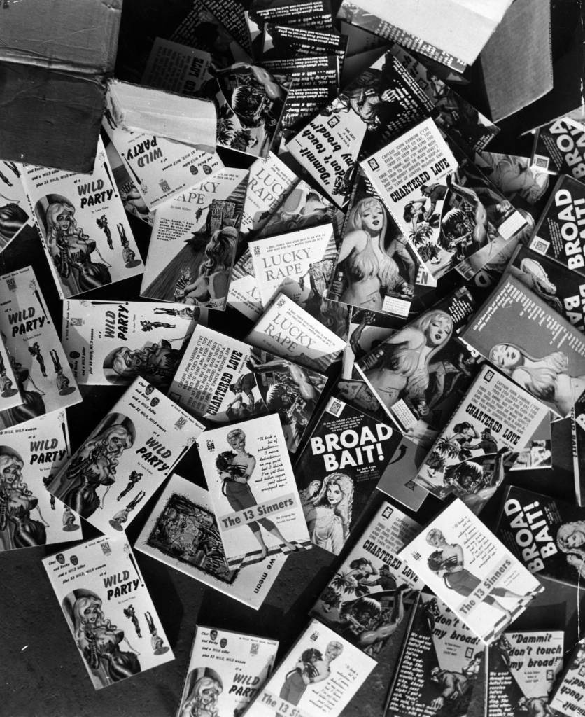7th February 1964:  Obscene books litter the floor of a shed at London docks waiting for incineration after being confiscated by Customs.  (Photo by Keystone/Getty Images)