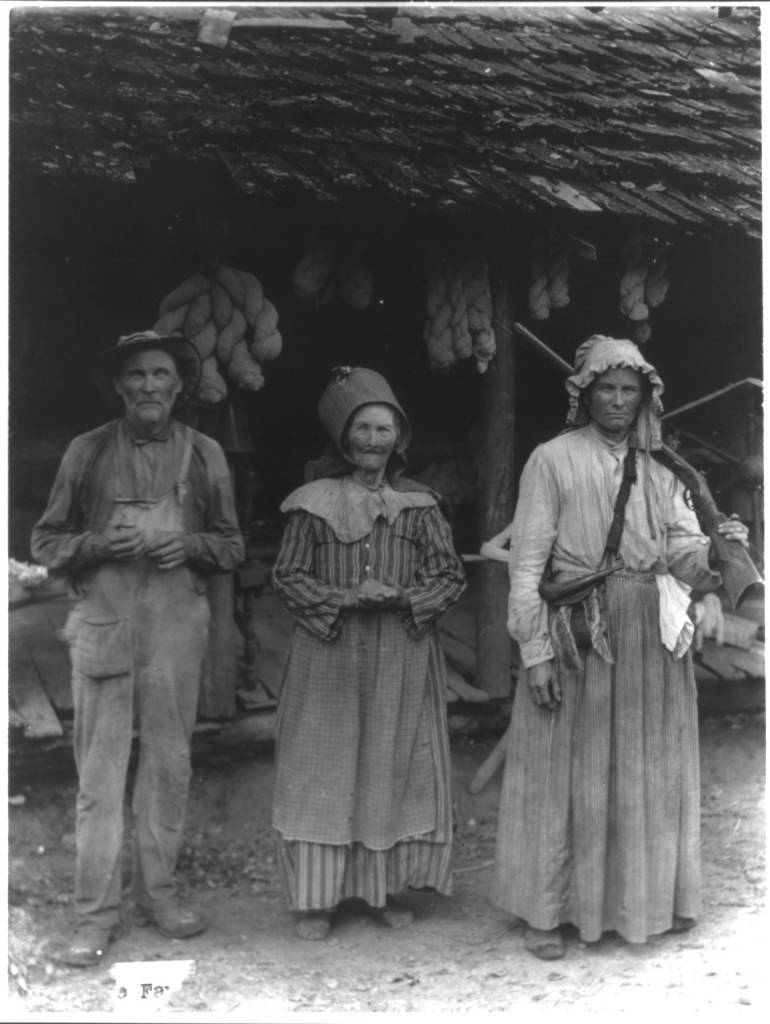 Title: The Faust family, Anderson County, E. Tenn. [Mountain man and 2 women in front of house] Date Created/Published: c1910.