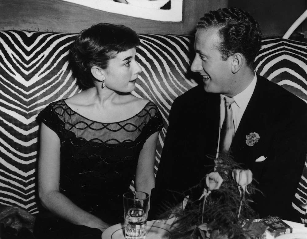 Actress Audrey Hepburn (1929 - 1993) at the El Morocco in New York with her fiance, British industrialist James Hanson, 1st December 1951. The two never in fact married. (Photo by Keystone/Hulton Archive/Getty Images)