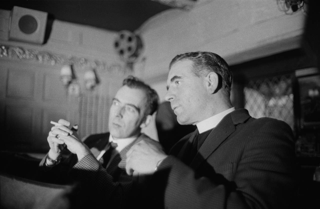 The reverend Vernon Mitchell studies a strip show to determine what segments should be censored, London, 1st November 1960. (Photo by Peter Dunne/Daily Express/Hulton Archive/Getty Images)