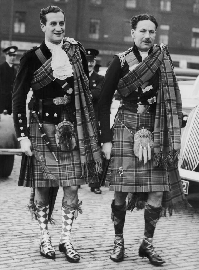 Lord David Douglas-Hamilton (1912 - 1944, left) arrives at Glasgow Cathedral for his wedding to fitness instructor Prunella Stack, 16th October 1938. On the right is his brother and best man, Lord George Douglas-Hamilton, 10th Earl of Selkirk (1906 - 1994). (Photo by Fox Photos/Hulton Archive/Getty Images)