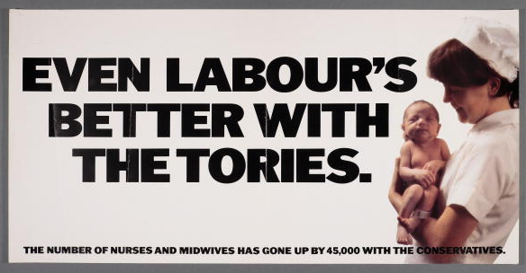 A poster for the British Conservative Party from the General Election, circa 1978. It depicts a nurse holding a newborn baby with the caption 'Even Labour's better with the Tories. The number of nurses and midwives has gone up by 45,000 with the Conservatives.'