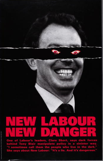 A poster for the British Conservative Party from the 1997 General Election. It depicts Labour candidate Tony Blair with a pair of demonic red eyes, accompanied by the caption 'New Labour New Danger'. Underneath is written 'One of Labour's leaders, Clare Short, says dark forces behind Tony Blair manipulate policy in a sinister way. 'I sometimes call them the people who live in the dark.' She says about New Labour: 'It's a lie. And it's dangerous.''