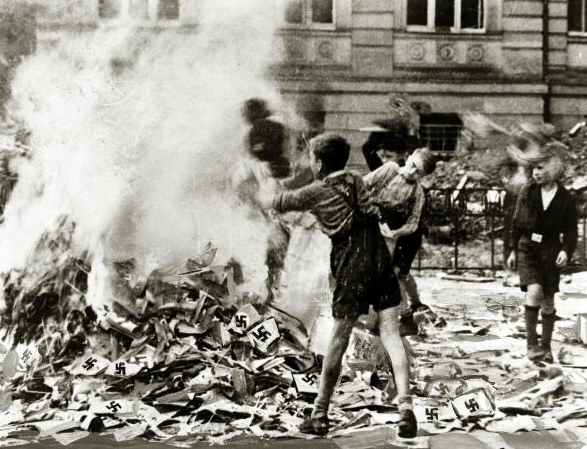 World War II, pic: circa 1945, German boys pictured burning Nazi books and swastikas in Cologne
