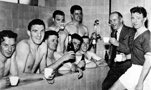 957. Manchester United celebrating winning the Division One League Championship 1956-1957 for the second year running. Players shown include John Berry, Bill Foulkes, Bill Whelan, Tommy Taylor, Bobby Charlton and captain Roger Byrne