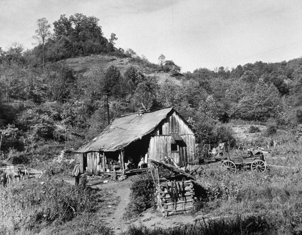 Small coal mining town in impoverished Appalachia, seven family members living in small shack.