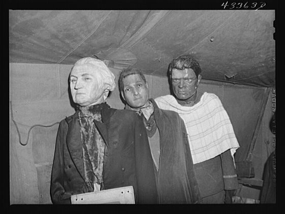 "Title: Effigies of Washington, Joe Louis and some criminal in a travelling sideshow ""crime museum"". Washington and Joe Louis are examples of ""what you may become if you go straight"". Near Fort Bragg, North Carolina Creator(s): Delano, Jack, photographer Date Created/Published: 1941 Mar."