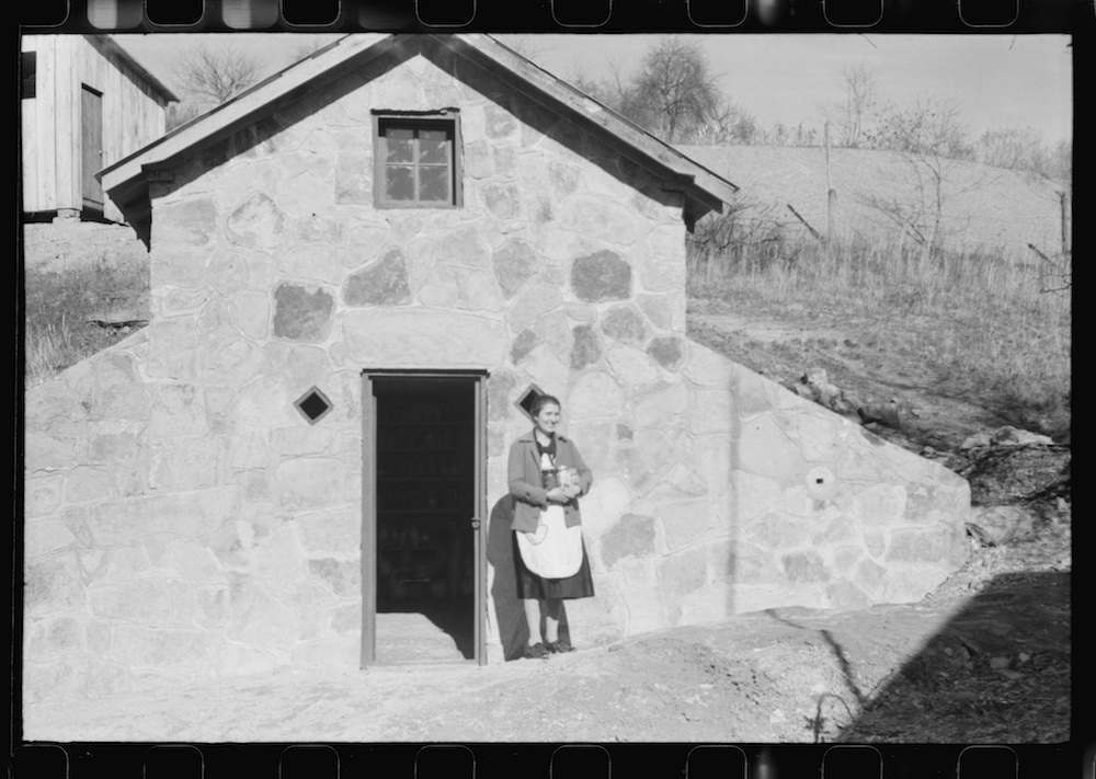 Mrs. S. Castle or Mrs. William S. Allen with canned goods in front of new storage house her husband built on their farm with FSA (Farm Security Administration) help. Southern Appalachian project, near Barbourville, Knox County, Kentucky 1940