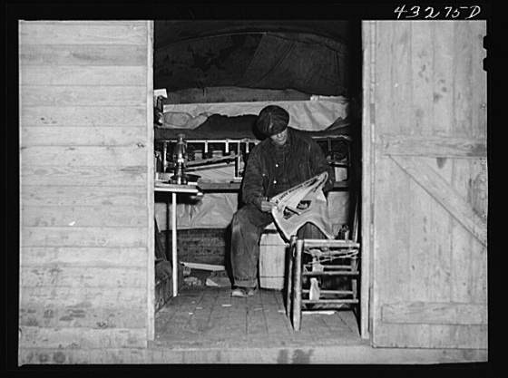 Title: This man is a carpenter at Fort Bragg, North Carolina. This converted truck is his home. The interior of his truck was more roomy than most of the cabins that had been built at the camp where he was staying. At a settlement near Silver Lake, North Carolina (about ten miles out of Fayetteville, N.C.) Creator(s): Delano, Jack, photographer Date Created/Published: 1941 Mar.