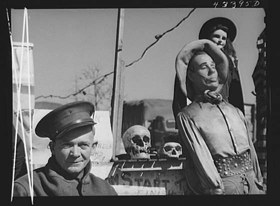 """Title: At the travelling sideshow """"crime museum"""" with the owner, an old war veteran, and some of his """"specimens"""". Near Fort Bragg, North Carolina Creator(s): Delano, Jack, photographer Date Created/Published: 1941 Mar."""
