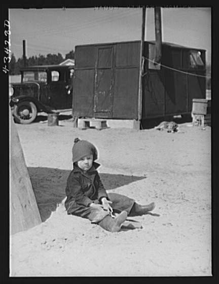 Title: In a trailer settlement of migrants working at Fort Bragg. Near Fayetteville, North Carolina Creator(s): Delano, Jack, photographer Date Created/Published: 1941 Mar.