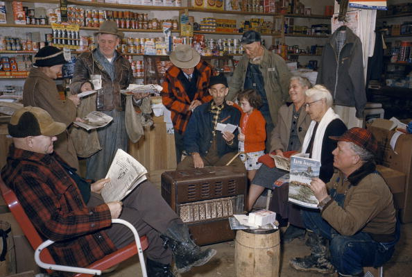 A postman delivers mail to people in the local general store, Chloe, West Virginia