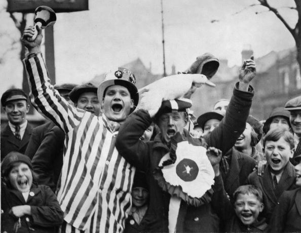 Cheering Arsenal fans with a duck, London, England, Photograph, April 26th 1930