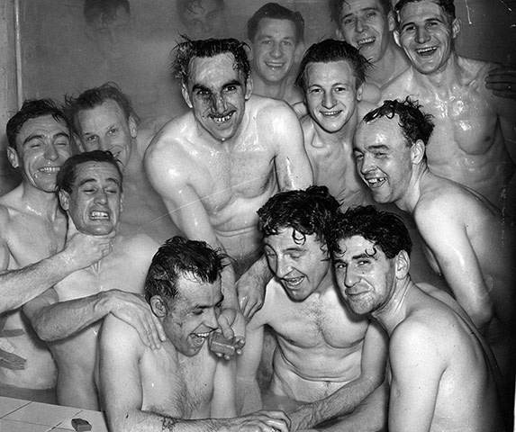 Members of the 1950 Brentford team in the bath after a training session in Ramsgate before their FA Cup tie against Chelsea