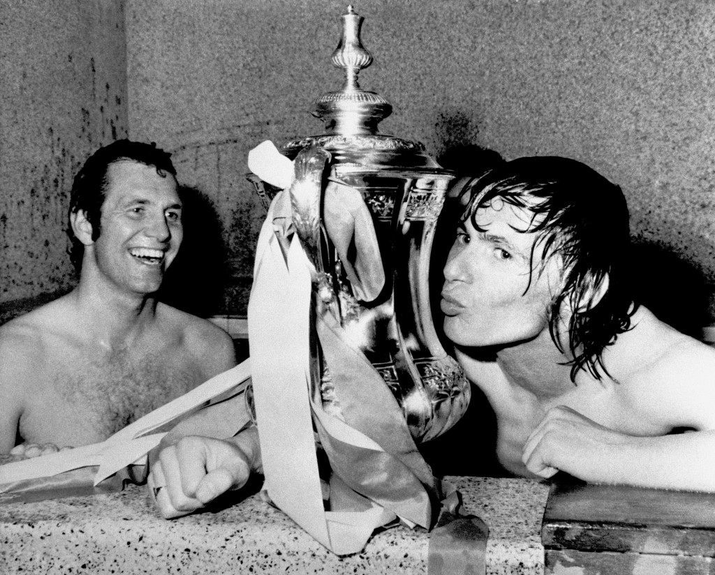 Soccer – FA Cup – Final – Manchester United v Southampton Southampton's winning goalscorer Bobby Stokes (r) kisses the FA Cup as teammate Peter Osgood (l) looks on