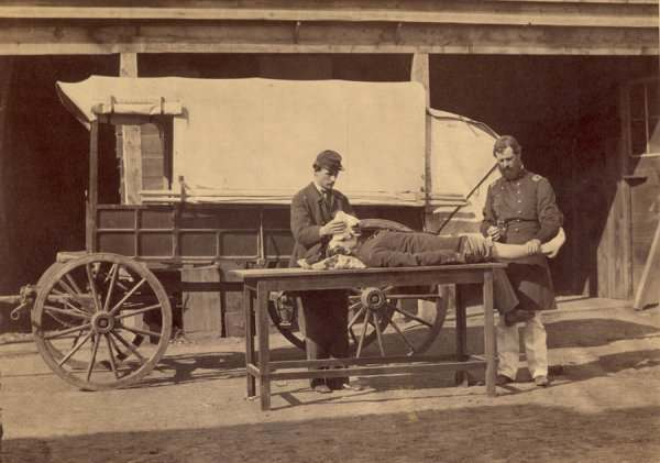"""Army Medical Wagon."" Demonstration of the use of anesthesia in amputations."